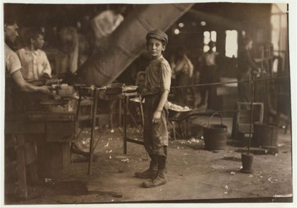 """Carrying-in"" boy in Alexandria Glass Factory, Alexandria, Va. Works on day shift one week and night shift next week. Lewis Hine (1911). Courtesy the Library of Congress, Washington, D.C."